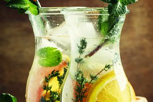 Citrus cool lemonade in glass jugs,