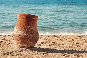 old earthen pitcher standing on the