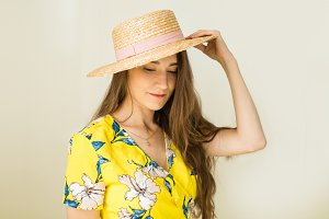 girl holding a straw hat
