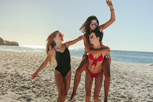 Woman friends enjoying on beach