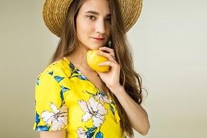 girl in yellow dress and hat