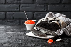 Cuttlefish ink bread and red caviar