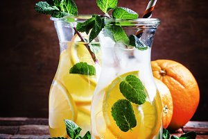 Cold drink with orange, mint and ice
