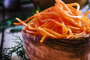 Marinated carrots in a wooden bowl,