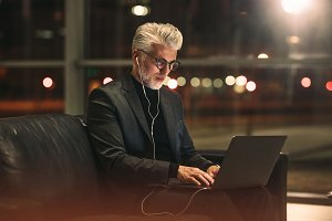 Mature businessman working on laptop