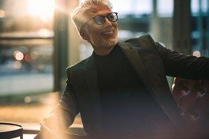 Smiling mature businessman sitting