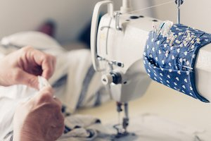 The dressmaker sews at the sewing ma