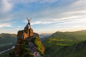 Happy woman on top mountain