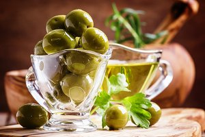 Spanish green olives in glass bowl a