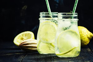 Summer lemonade with soda and ice in
