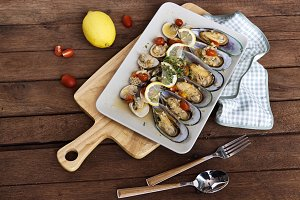 Mussels in a plate on the wooden