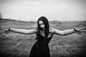 Wicked goth girl in autumn field