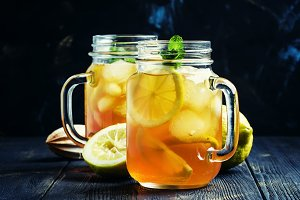 Black ice tea with lemon in a glass