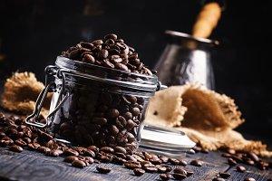 Coffee beans in a glass jar, black b