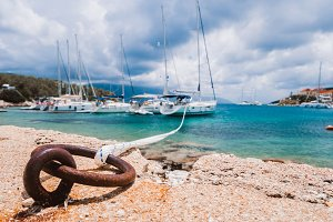 Mooring rope tied to rusty ring for