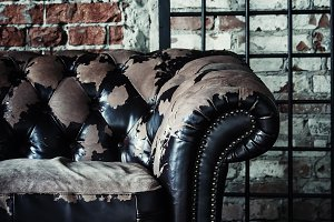Old vintage sofa on background of br