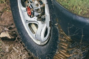 Muddy wheel of a 4x4 car