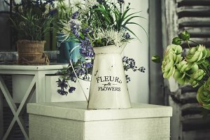 Vintage vase with flowers, toned blu