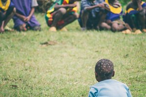 Ethiopian boy sitting on the grass