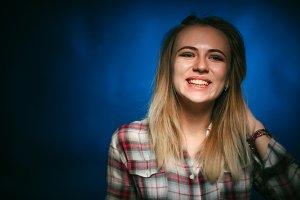 portrait smiling girl on blue backgr