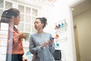 Two business women talking in an off