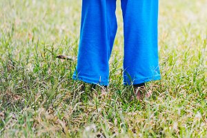 Legs of ethiopian girl in the grass