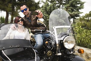 Couple at bike taking selfie
