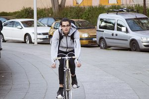 young man cycling around the city do