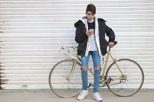 young urban fashion with bike and mo
