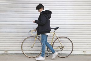 young urban fashion with bike and mo