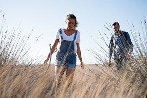 Woman and man walking through long g