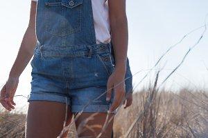 Woman walking on a grassy plain
