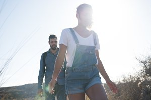 Couple walking in the mountains in t