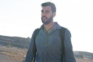 Man walking in the desert looking up