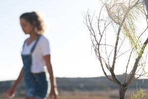 Woman walking in the desert looking