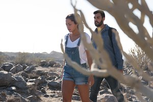 Couple walking through the desert pa