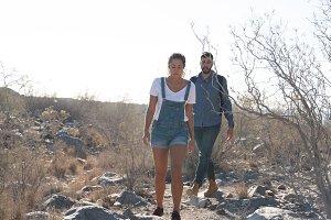 Couple walking through the desert on