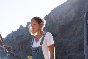 Woman walking along a rocky path