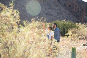 Couple standing in tall brown grass