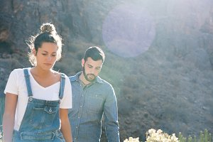 Couple hiking in the mountains on a