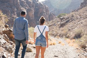 Couple walking down a rocky path in