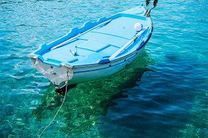 Blue fishing boat in the emerald