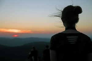 Silhouette of a young woman at