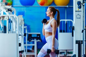 Attractive young woman working out