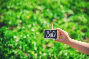 bio farm sign in the hands of a kid