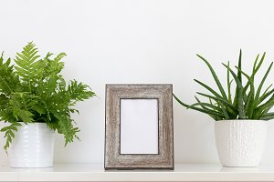 Wooden photo frame and greenery