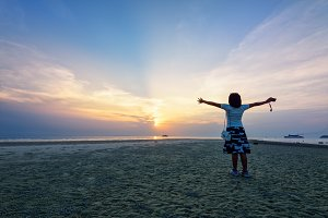 Woman standing arms outstretched at