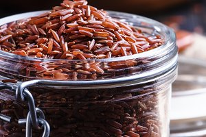 Raw red rice, dark background, selec