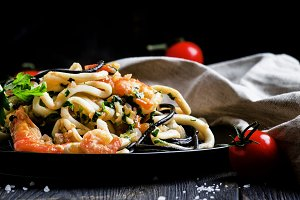 Black pasta with seafood and tomato
