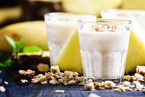 Milk smoothies with banana, pineappl